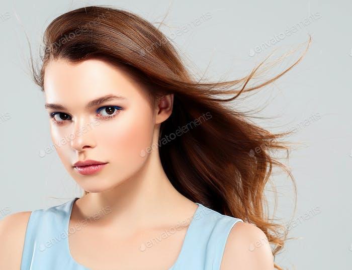 Beautiful Woman Brunette Healthy Beauty Skin Smile. Spa Beautiful Model Girl on gray background.