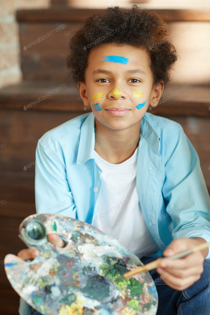 Young artist with paints