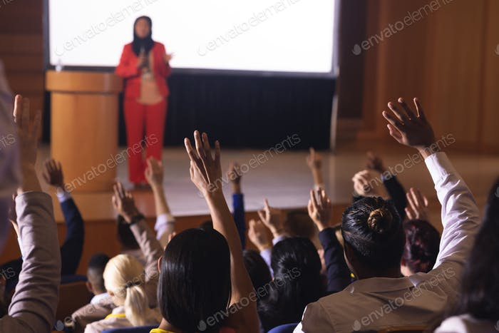 Businesswoman standing around the podium in the auditorium