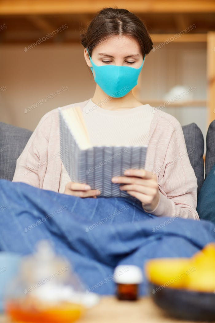 Sick woman reading a book