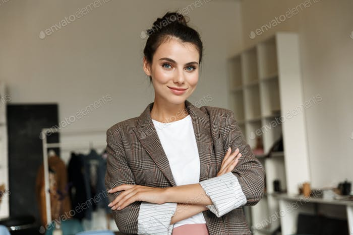 Attractive confident young woman standing at the office