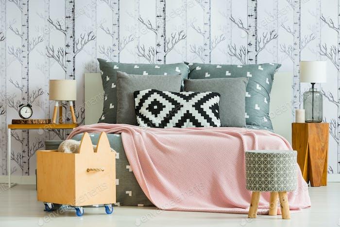 Decorative pillow in feminine bedroom