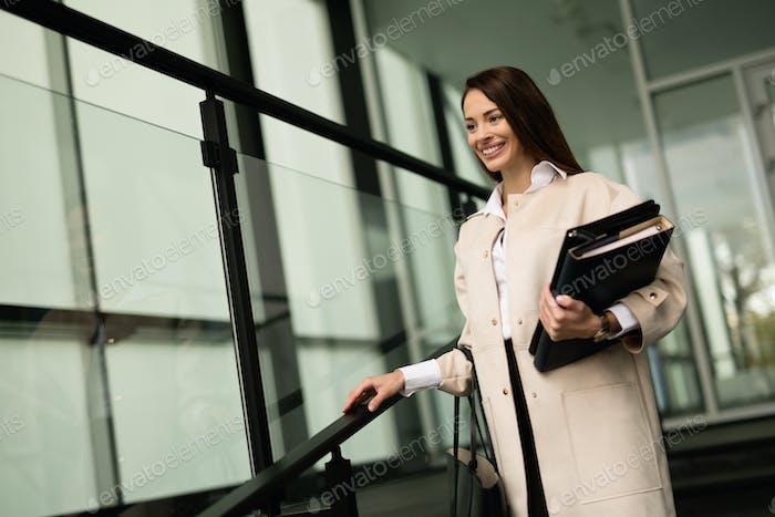 Beautiful businesswoman outdoors