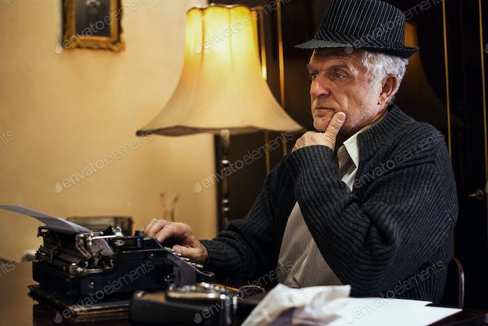 Wistful Retro Senior Man Writer