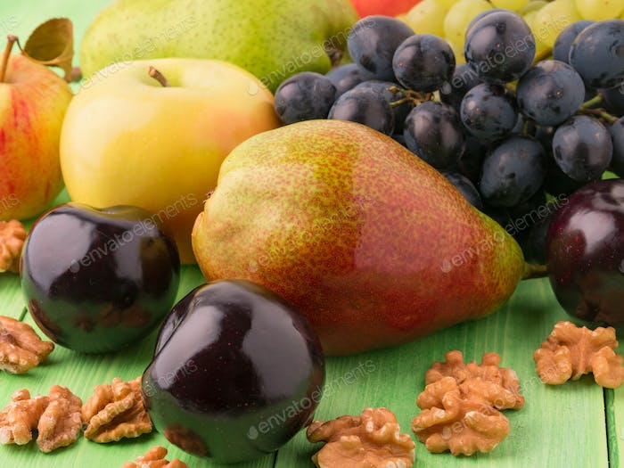 set of fruits on a green wooden table
