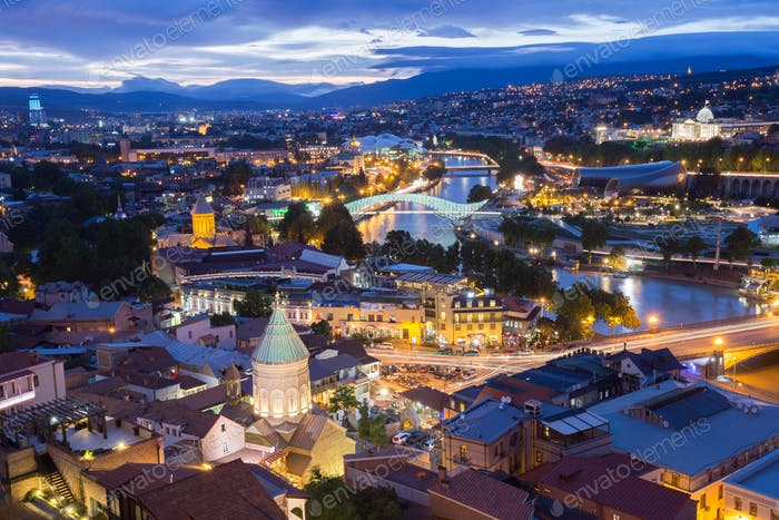 Scenic Top View Of Tbilisi Georgia In Evening Lights Illuminatio