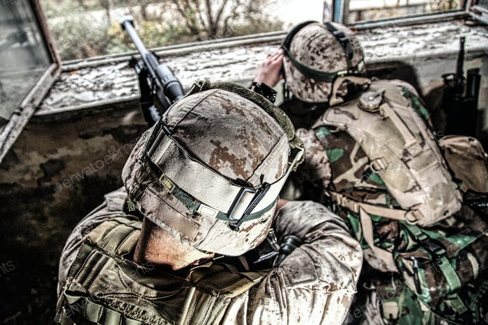 Army sniper team shooting with large caliber rifle
