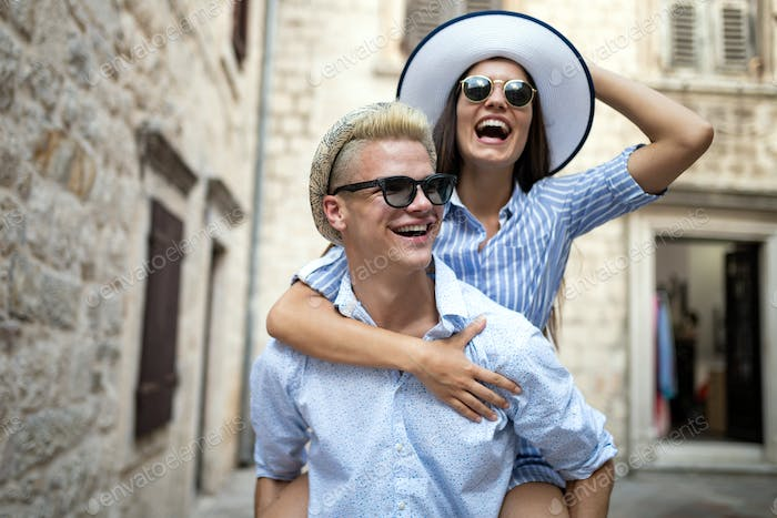 Romantic happy tourist couple hugging on summer vacation