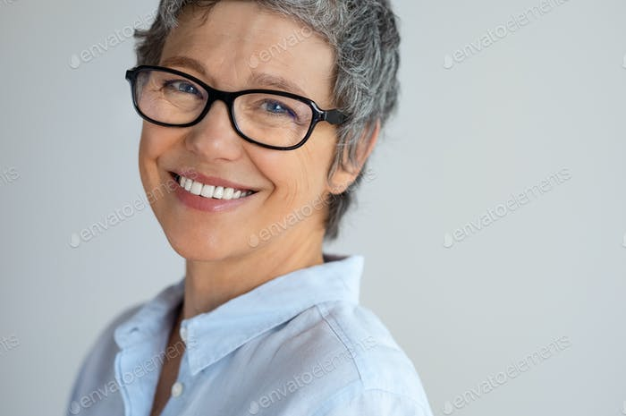 Happy senior woman with spectacles