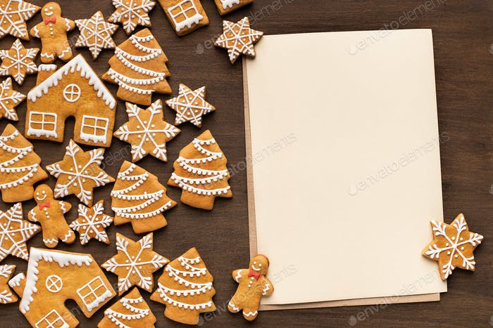 Christmas greeting. Gingerbread cookies with empty paper
