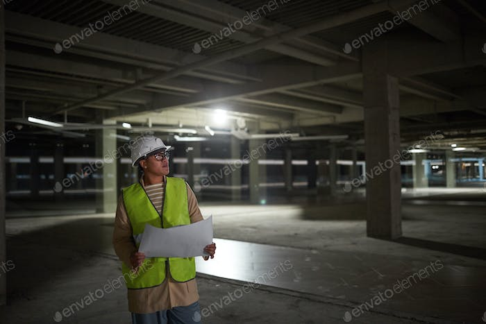 Female Engineer Inspecting Building