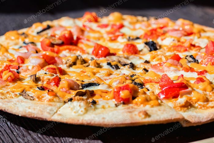 Delicious fresh pizza with tomatoes, mushrooms and cheese close up