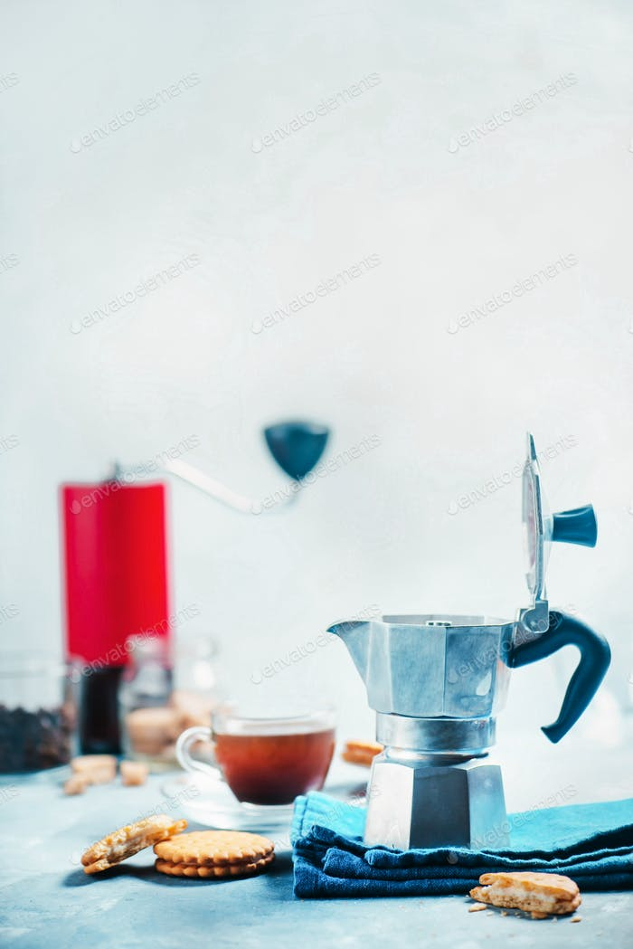 Brewing coffee in Moka pot. Morning coffee with cookies concept with copy space