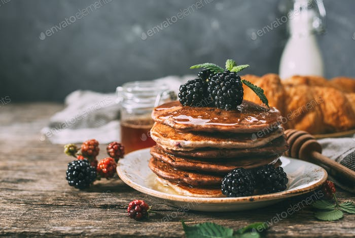 Homemade pancakes with berries and honey