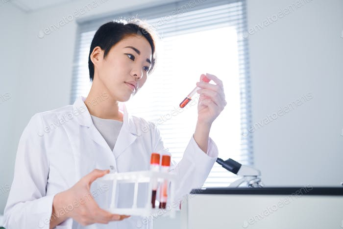 Medical researcher testing sample in laboratory
