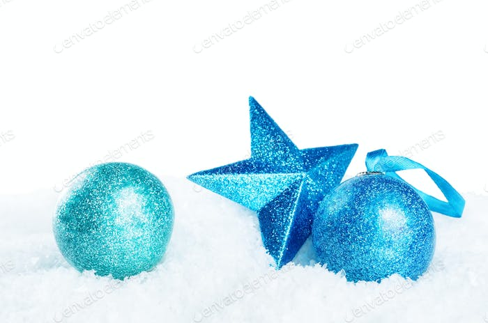 Christmas colored balls with star on snow isolated background
