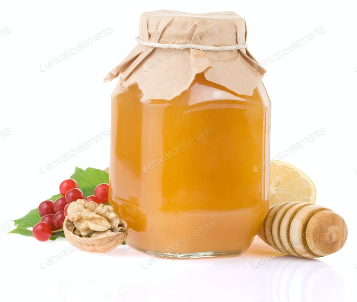 glass jar full of honey and fruit
