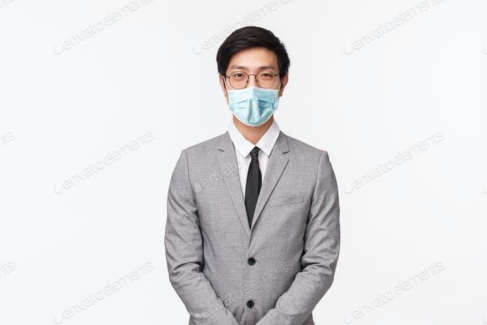 Business, finance and career concept. Portrait of professional handsome young asian man in grey suit