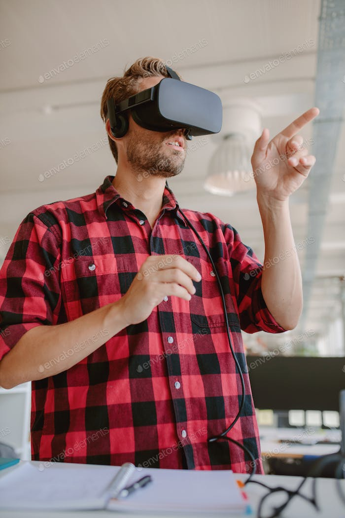 Developer using virtual reality simulator headset