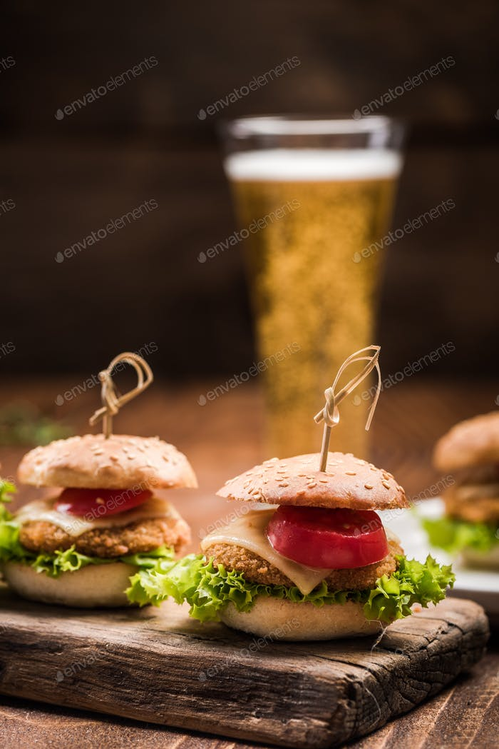 Chicken burgers served with beer in pub