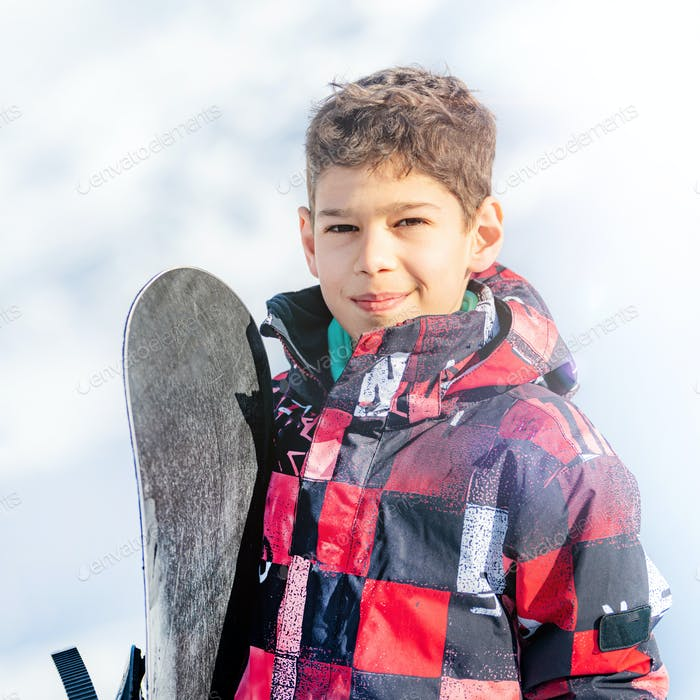 Portrait of Boy with Snowboard