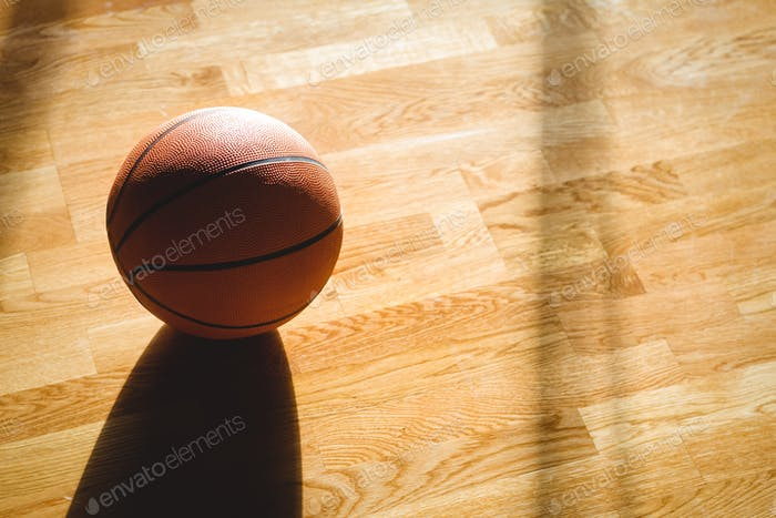 High angle view of basketball on hardwood floor