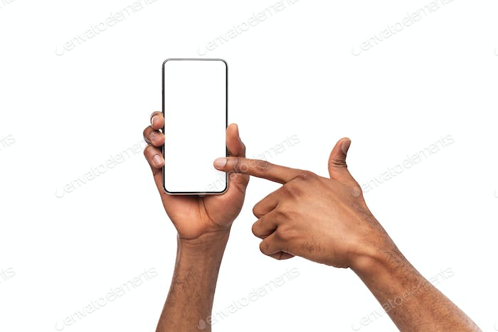 Male hands holding and pointing at smartphone with blank screen