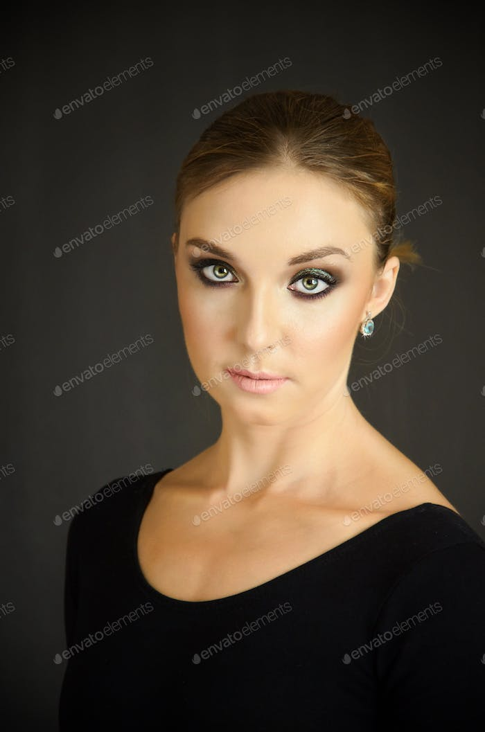 Young woman portrait looking straight ahead
