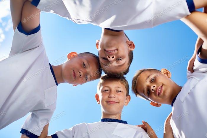 Junior Football Team Huddling