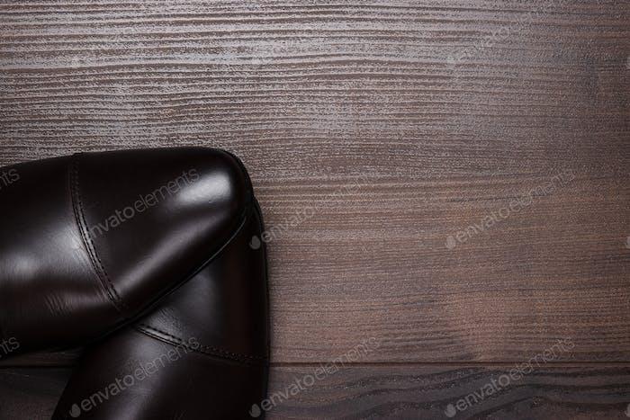 Shy Man Standing On Wooden Floor