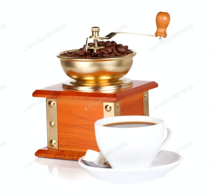 isolated coffee grinder and cup