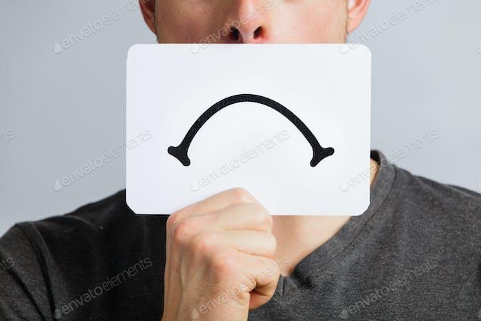 Unhappy Portrait of someone Holding a Sad Mood Board