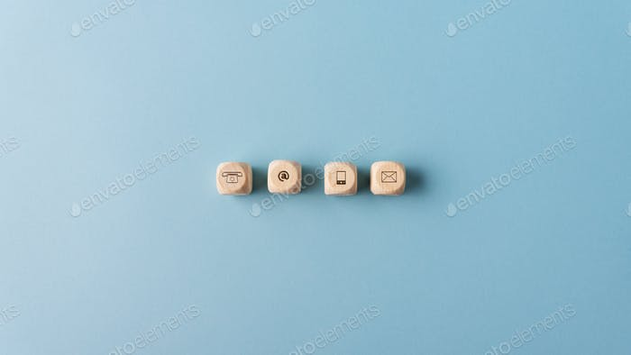 Contact and communication icons on wooden dices