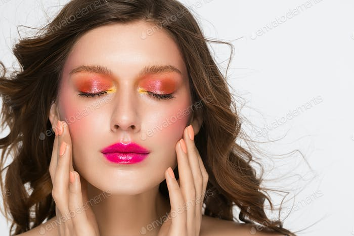 Colorful makeup woman face, beautiful brunette, beauty fashion girl model pink lips. Gray background