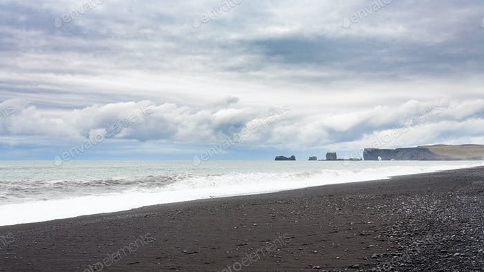 Reynisfjara Beach and view of Dyrholaey promontory