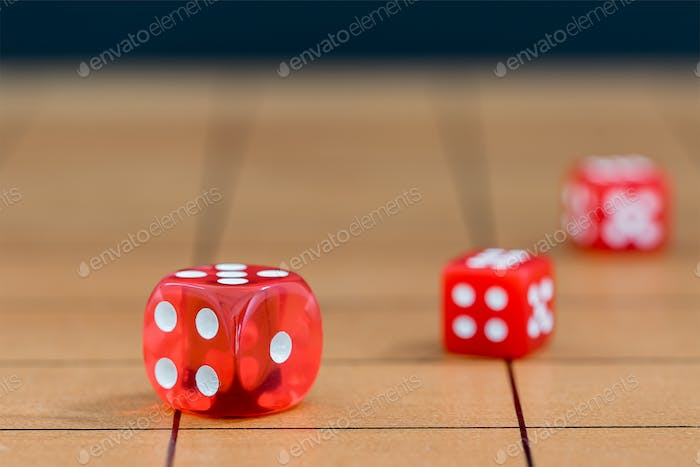 Red dices on wood board