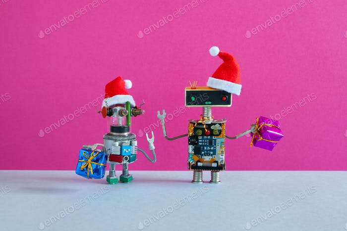 Small and big robots dressed as Santa Claus with bags of gifts