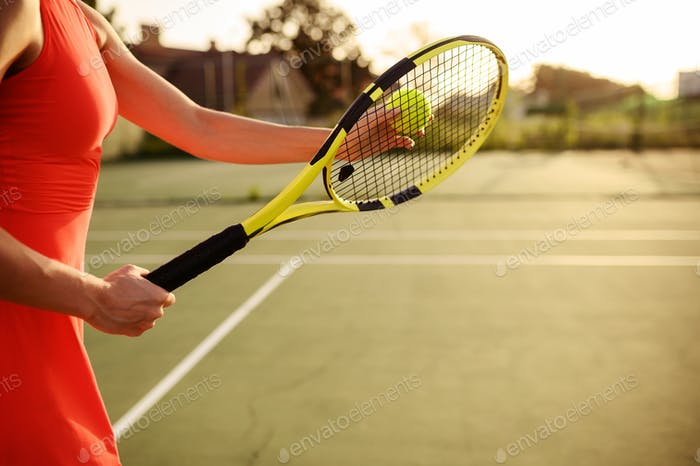 Female tennis player with racket and ball