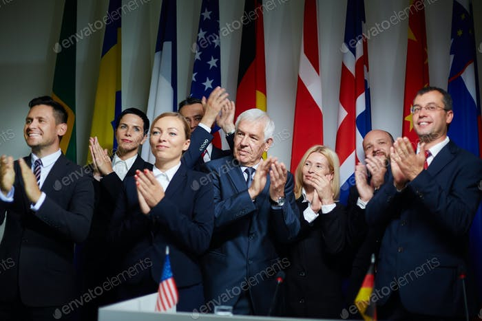 Group of delegates applauding