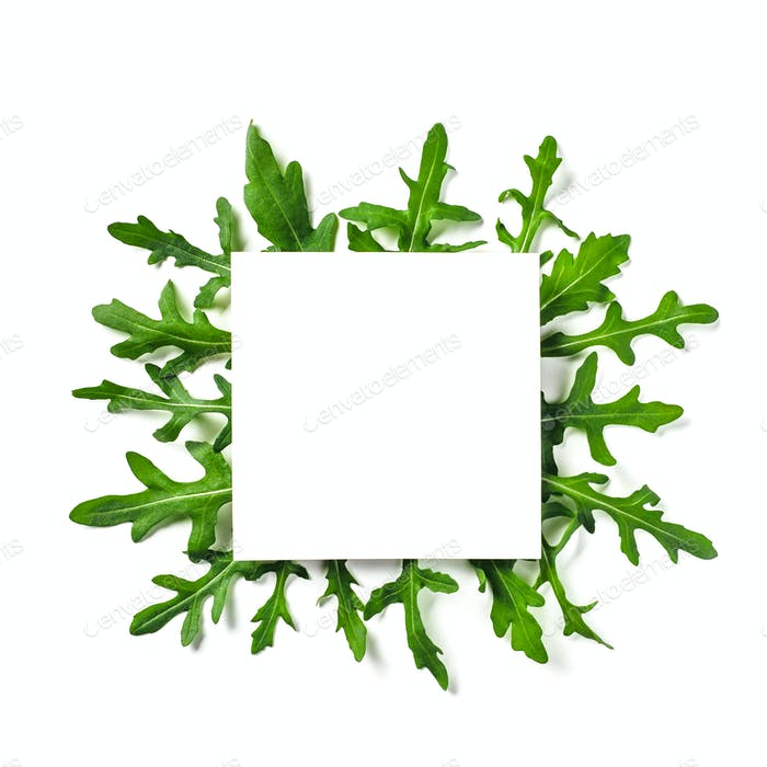 White paper square on arugula leaves