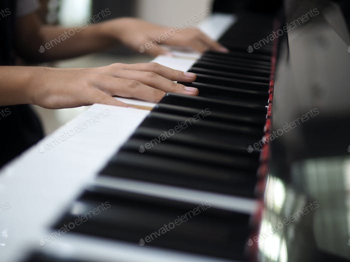 Child hand on piano keys