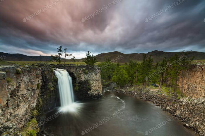 Landscape with a view of the waterfall and beautiful sky. Mongolia. Ulaan Tsutgalan