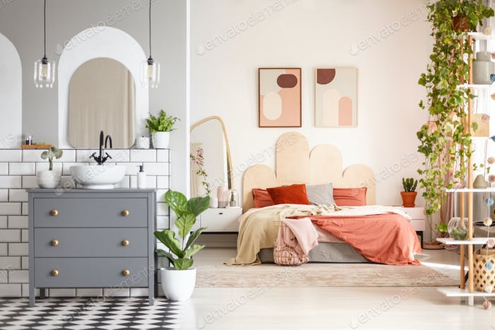 Real photo of a bathroom space with a cupboard, washbasin and a