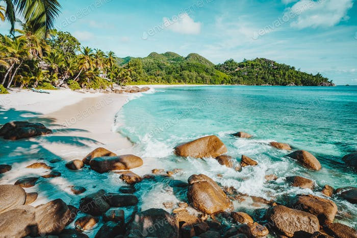 Mahe, Seychelles. Beautiful Anse intendance, tropical beach with ocean wave rolling towards sandy