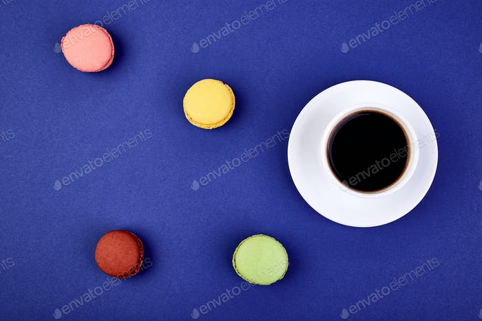 Sweet Dessert Macaron or macaroon with coffee