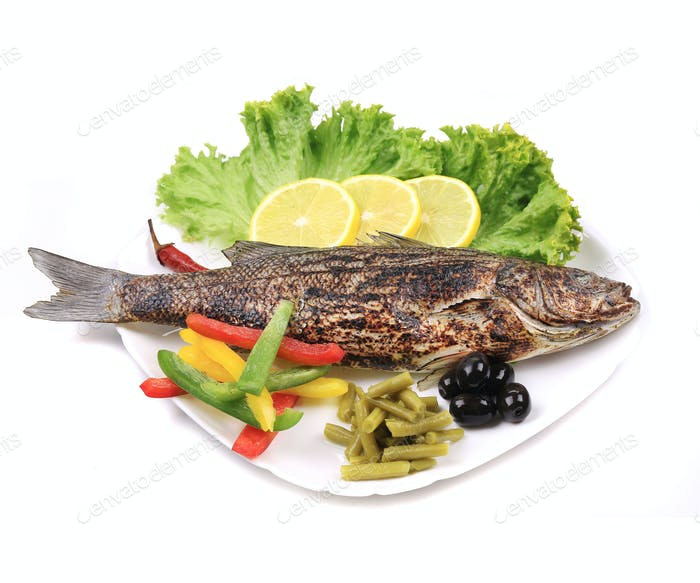Grilled seabass on plate.