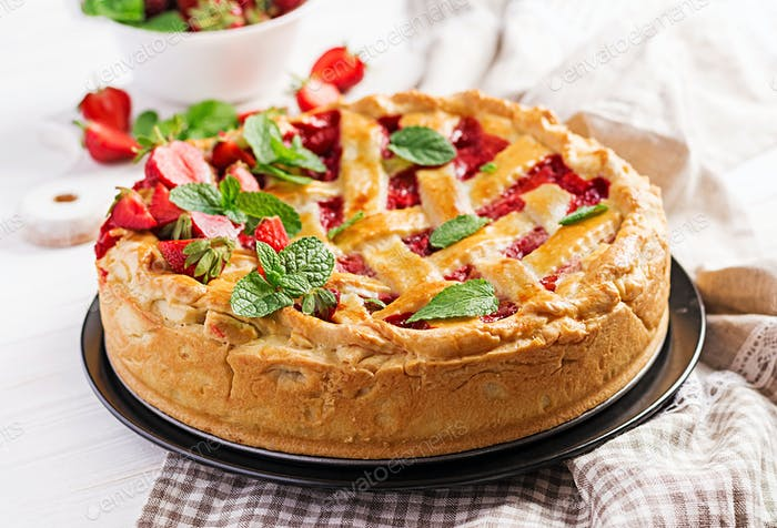 American strawberry pie tart cake sweet baked pastry food on white wooden table.