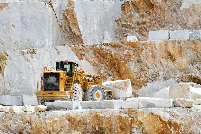 Heavy duty front end loader moving marble blocks