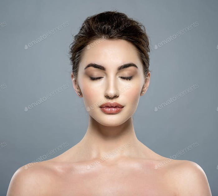 Beautiful face of a young  woman with clean fresh skin