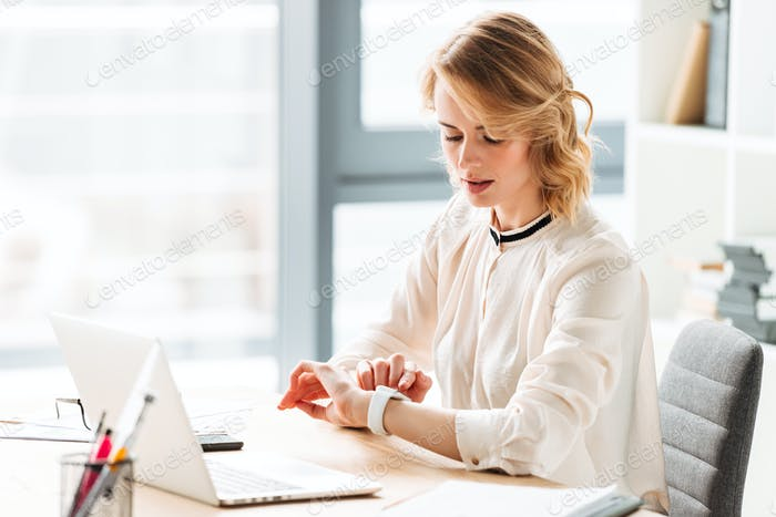 Portrait of a beautiful young businesswoman working